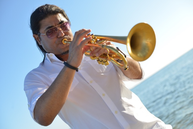DeShannon Higa trumpet on beach